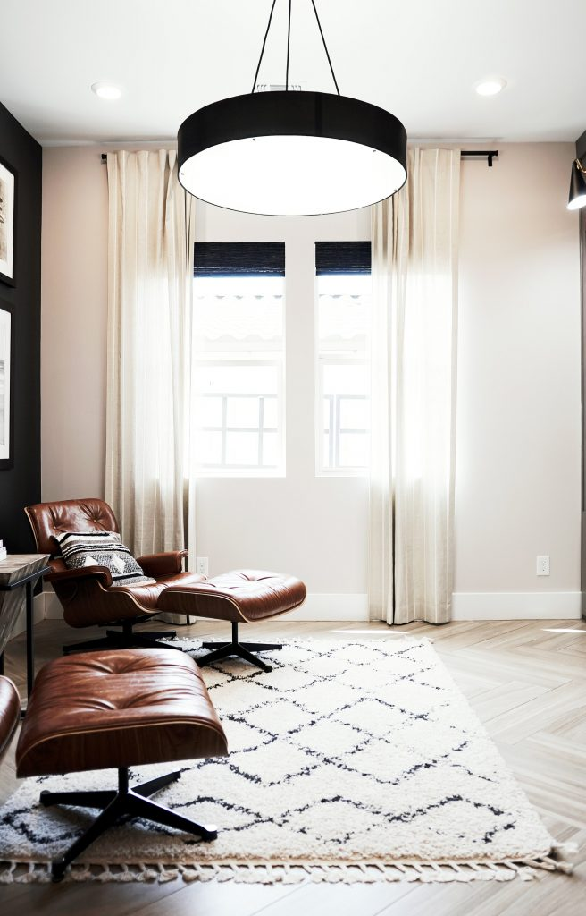 Leather Chairs On A Black And White Criss Cross Rug