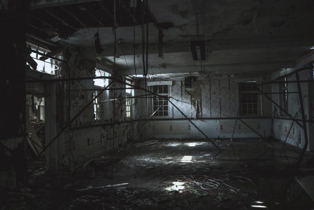 Rundown Dark Room With Debris, Clutter And Mold