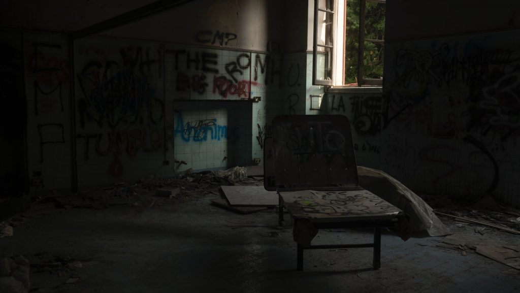 Vandalised Inside Of A Property With Graffiti And Debris