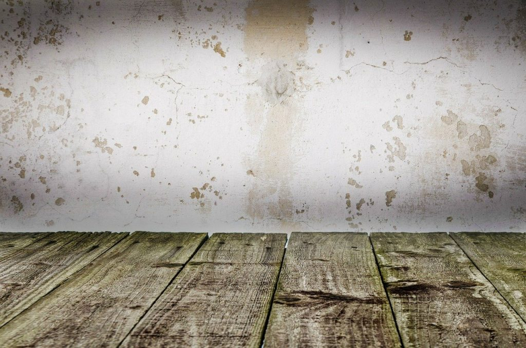 Wooden Floor With A Stained Wall