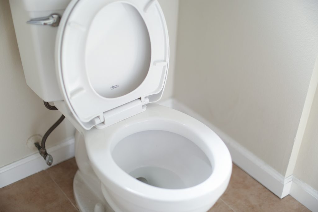 Clean White Toilet In A Bathroom