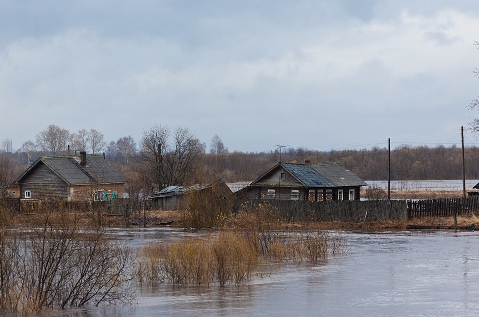 Damaged Houses Surrounded By Water