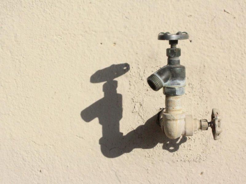 Water Spigot On Beige Wall