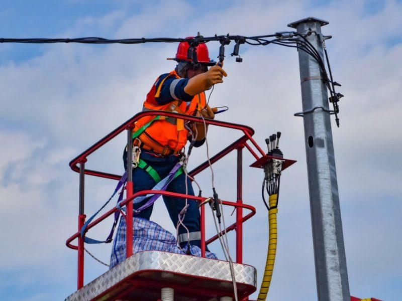 Electrician Repairing Power Line