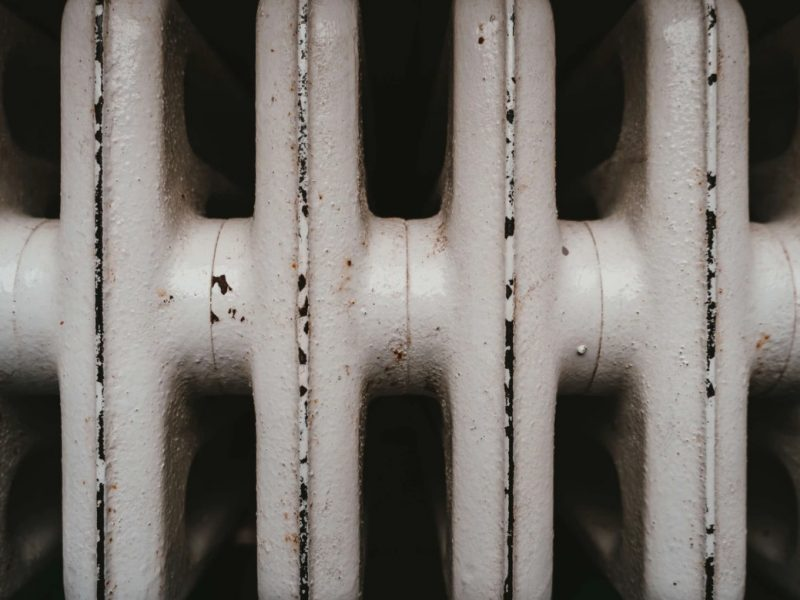 White Radiator With Flaking Paint