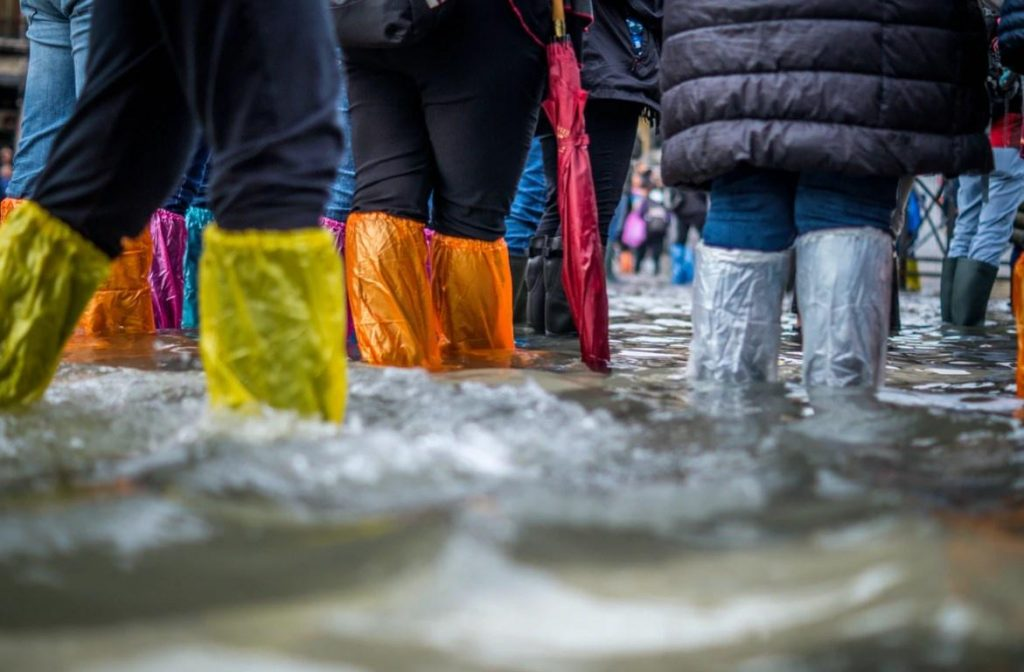 People Wearing Boots To Stay Dry During Flood