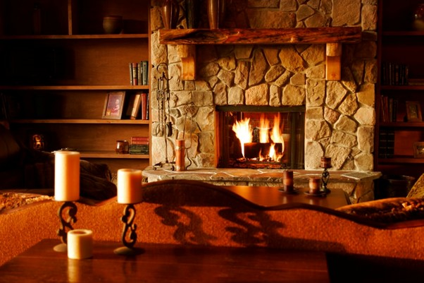 Stone Fireplace With A Burning Log