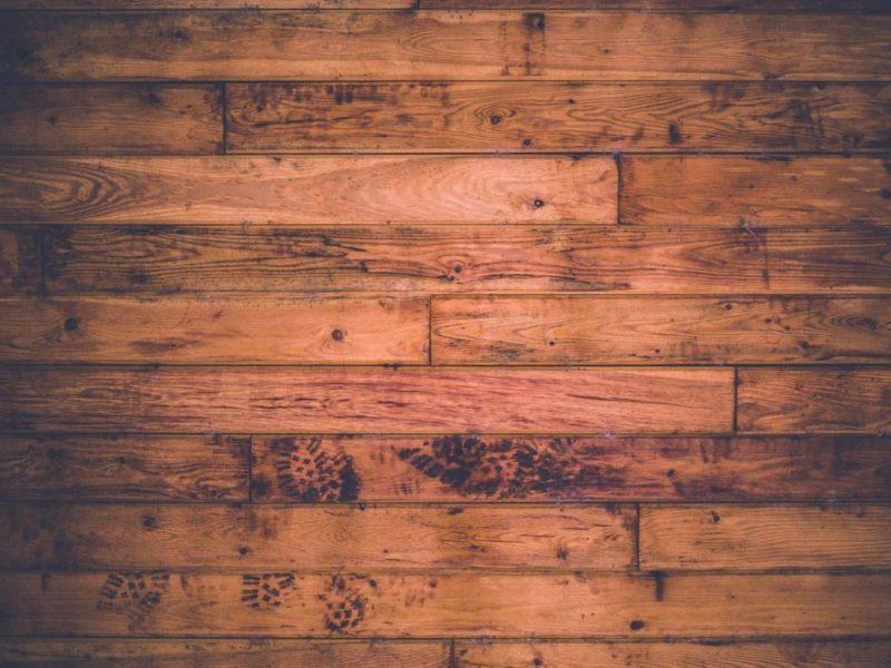 Wooden Floor With Muddy Footprints