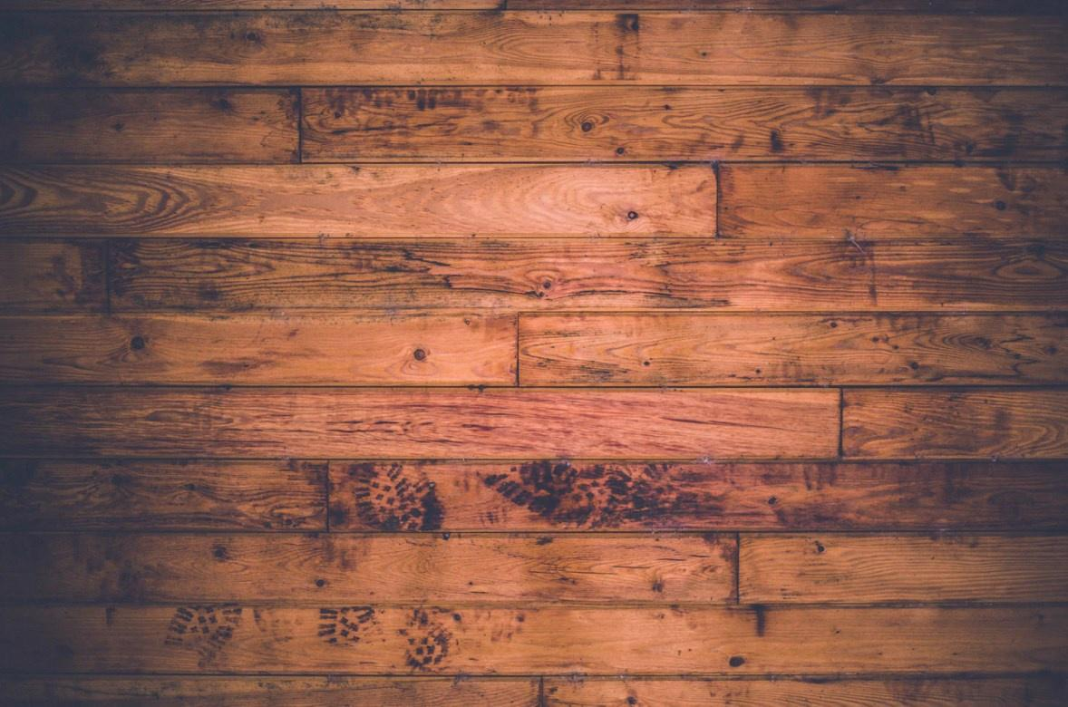 Wooden Floor With Muddy Footprints