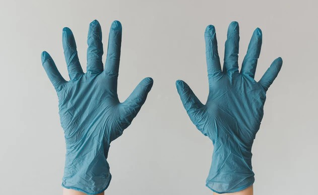 Person Wearing A Pair Of Blue Nitrile Gloves
