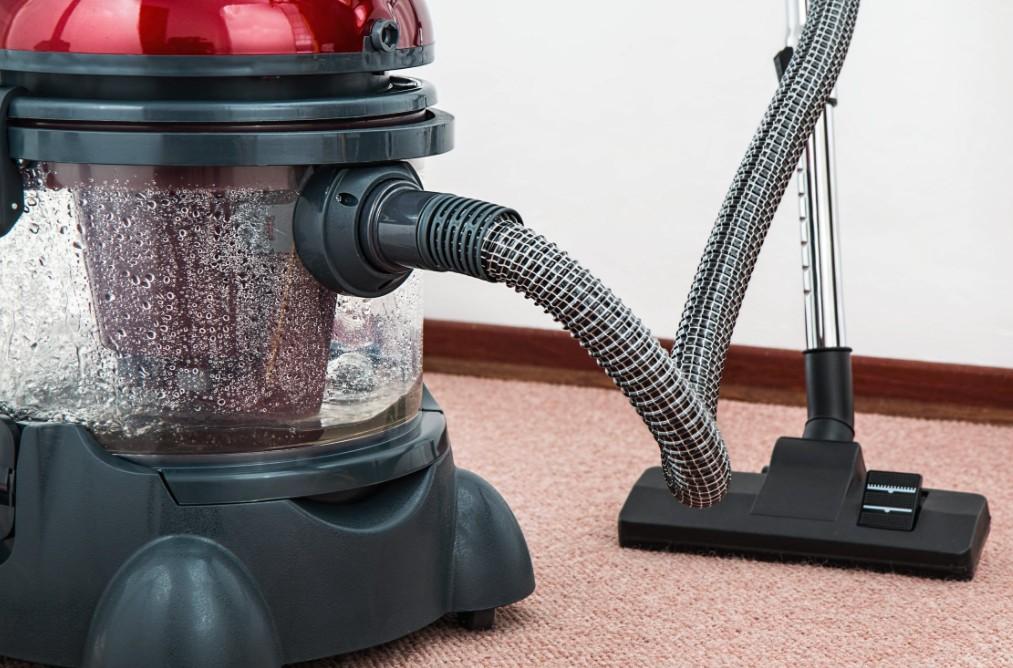 Red Vacuum On Carpet