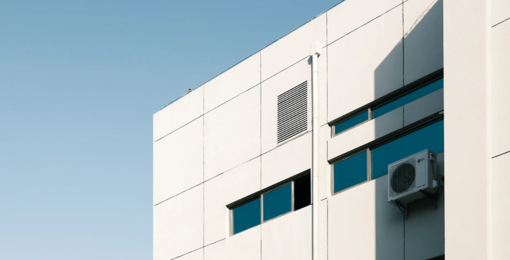 White Building With External AC Fan