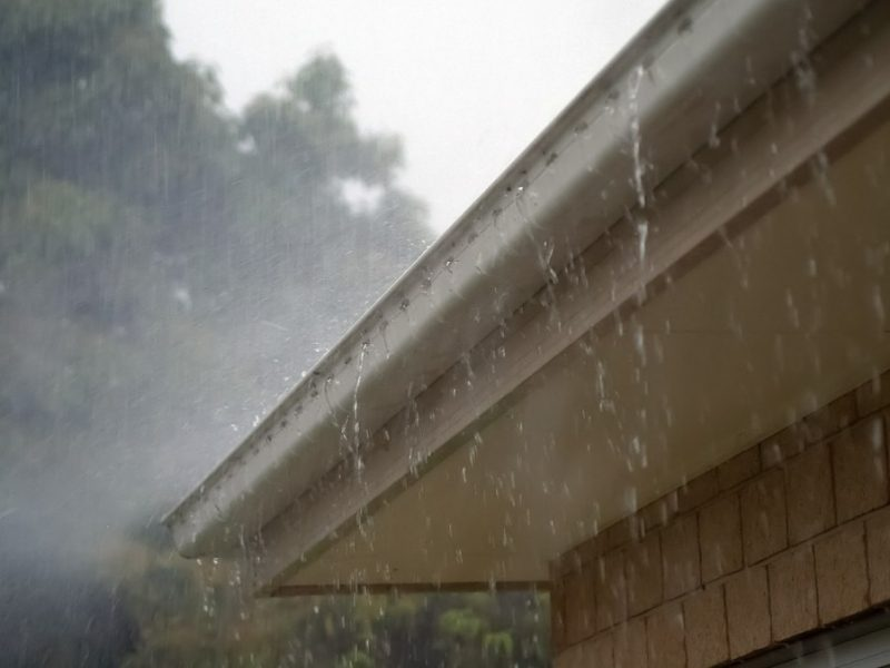 Heavy Rainfall Flowing Over Guttering