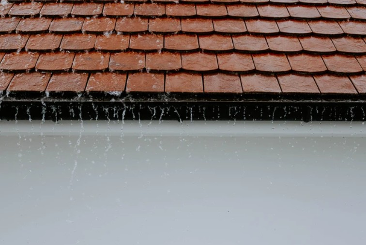 Rain Running Down Orange Roof Tiles