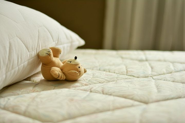 Brown Stuffed Bear On White Mattress