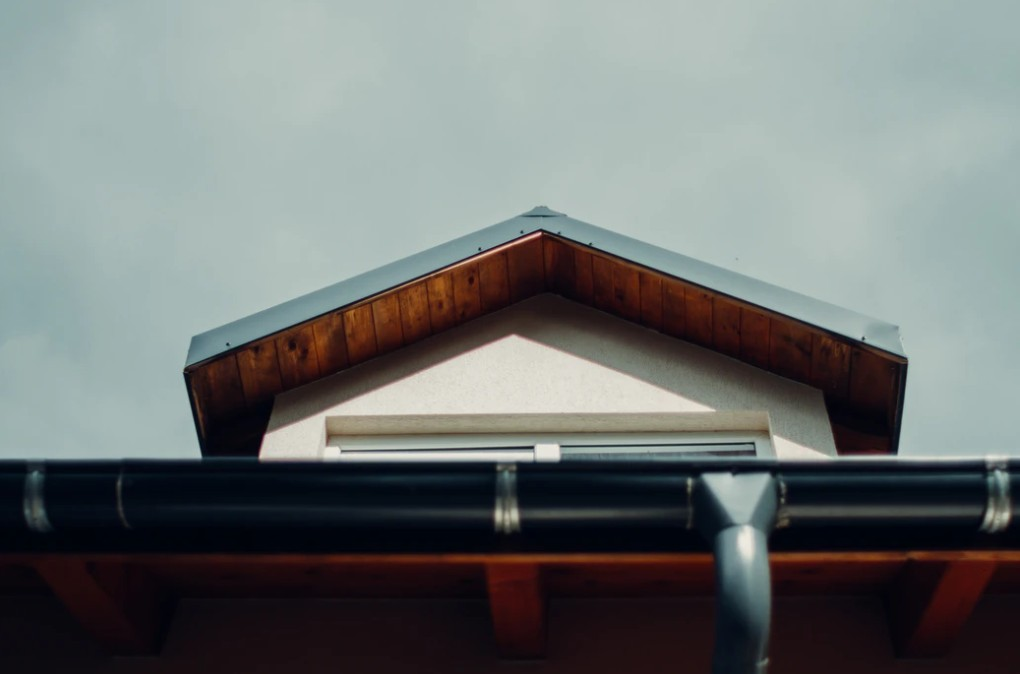 Brown Wooden Roof With Black Guttering
