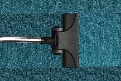 Vacuum On Blue Carpet