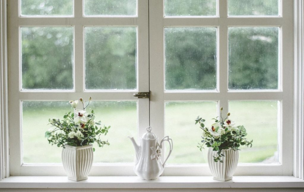 White Teapot In Front Of White Windows