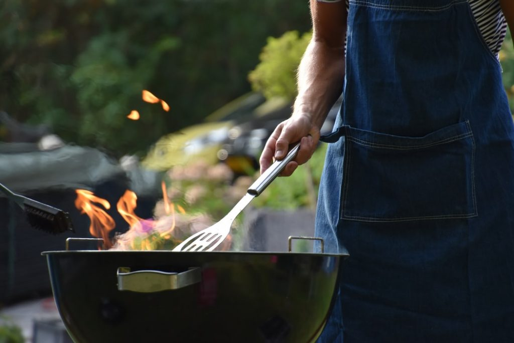 Person Grilling Food Outdoors