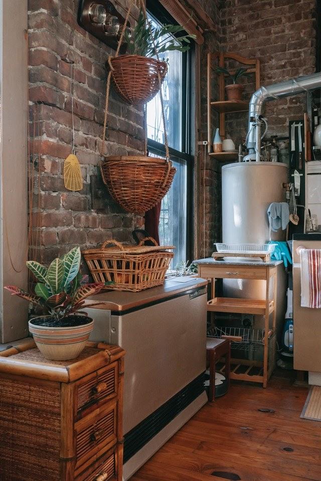 White Boiler Located In The Corner Of A Brick Room