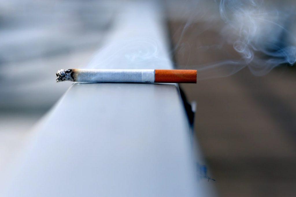 Cigarette On A Railing