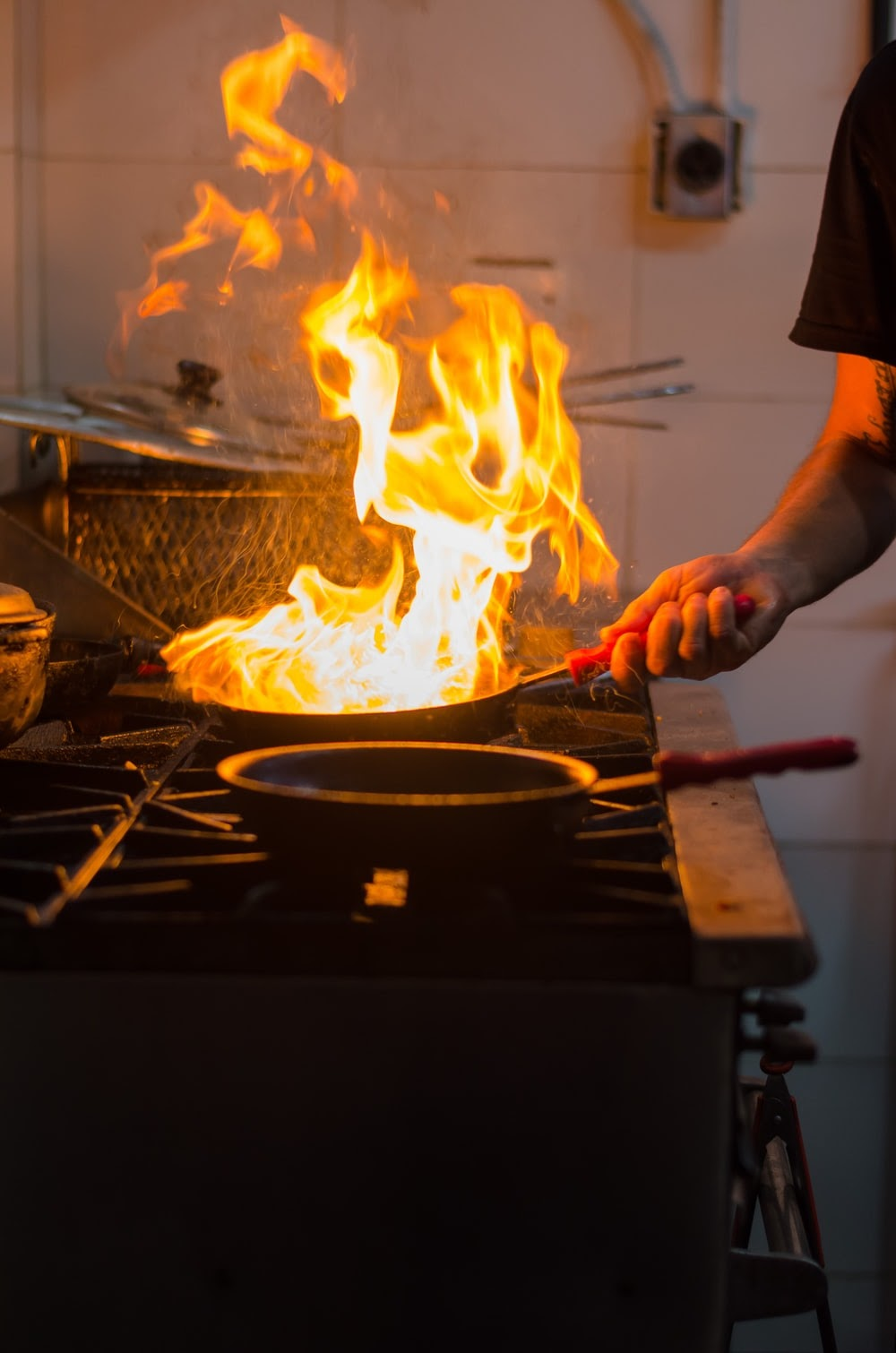 Flames Rising From A Pan On The Stove