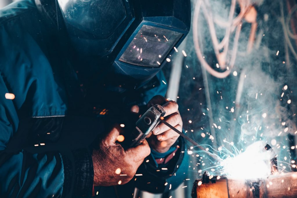 Person Welding In A Factory