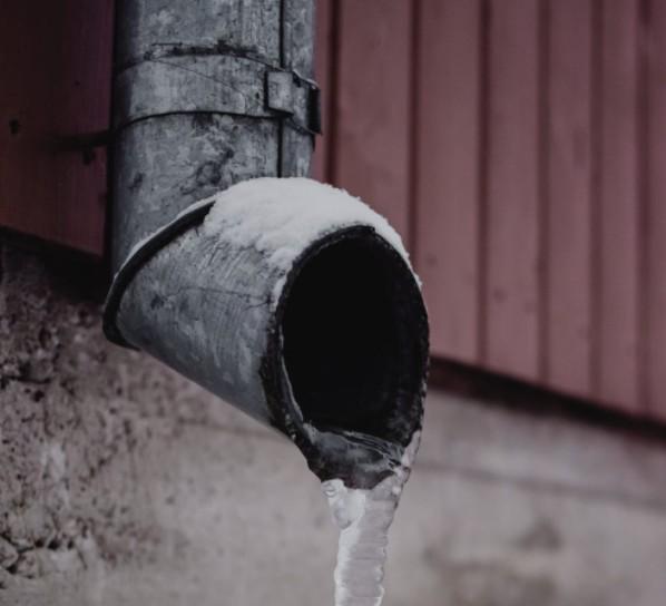 Frozen Water On Drain Spout